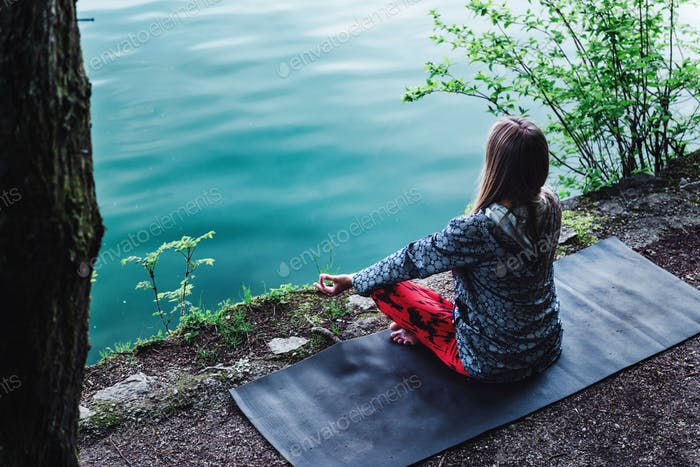 Meditating by the lake