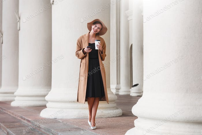 Girl in a brown coat a brown hat