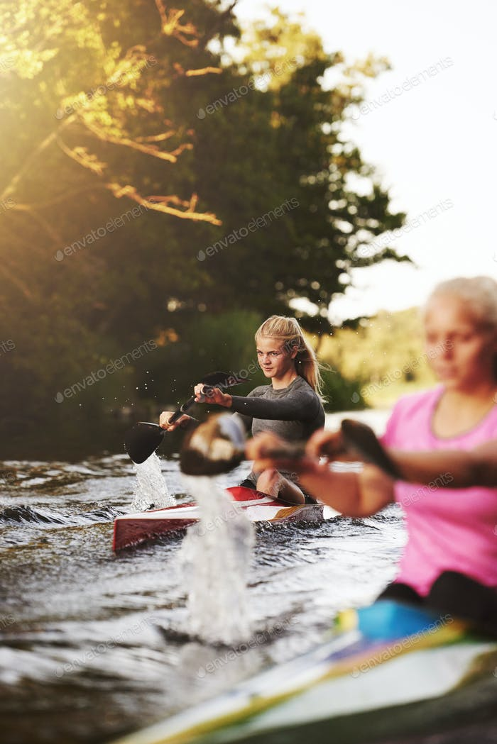 Two woman racing in kayaks