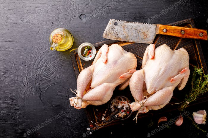 Whole Raw Chicken with Herbs and Spices .Food Ingredient Cooking Background