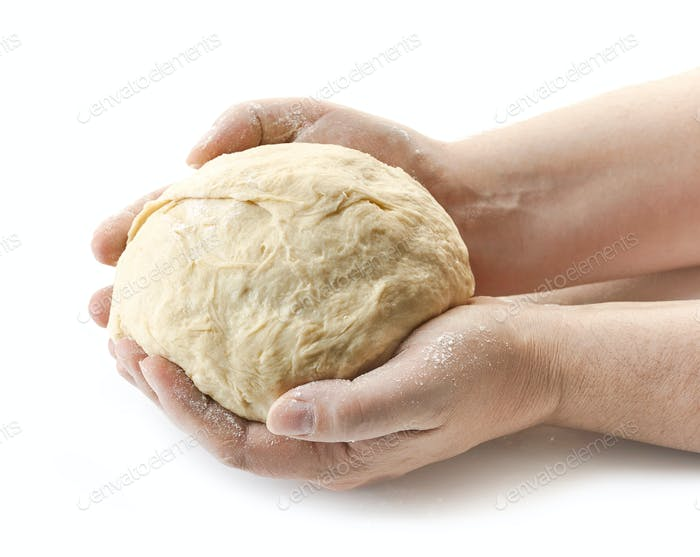 fresh raw dough in bakers hands