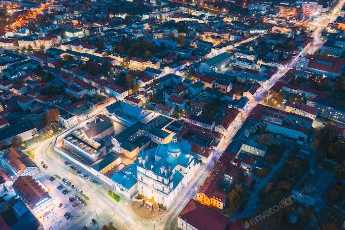 Grodno, Belarus. Night Aerial View Of Hrodna Cityscape Skyline. Popular Historic Landmark In Night