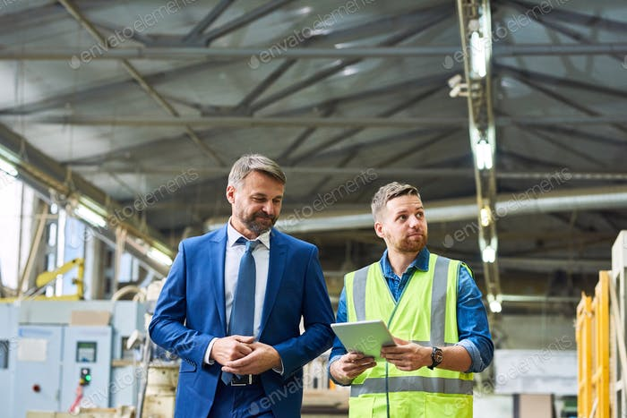 Mature Businessman Visiting Factory