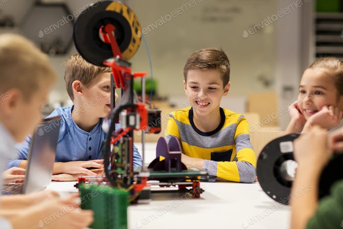 happy children with 3d printer at robotics school