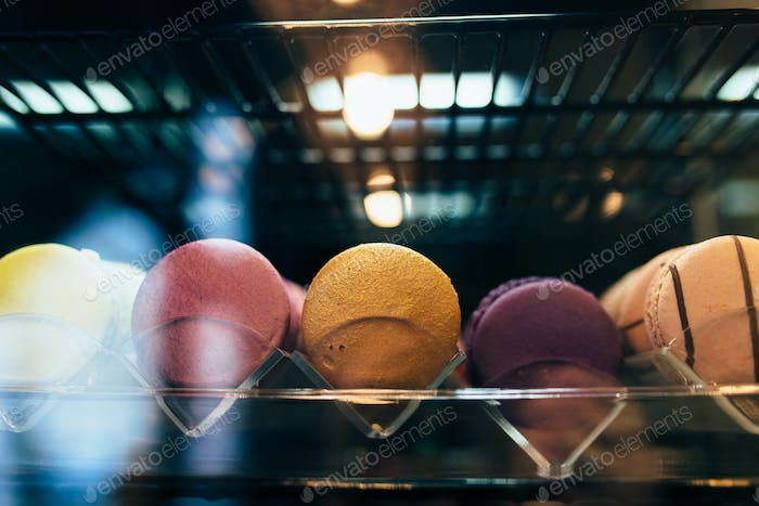 Multicolored macarons on a showcase in a cafe