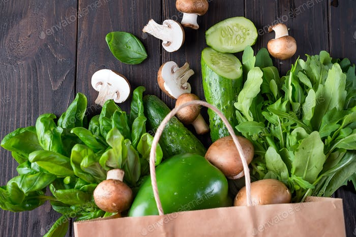 Close up of green vegetables on wooden background, flat lay