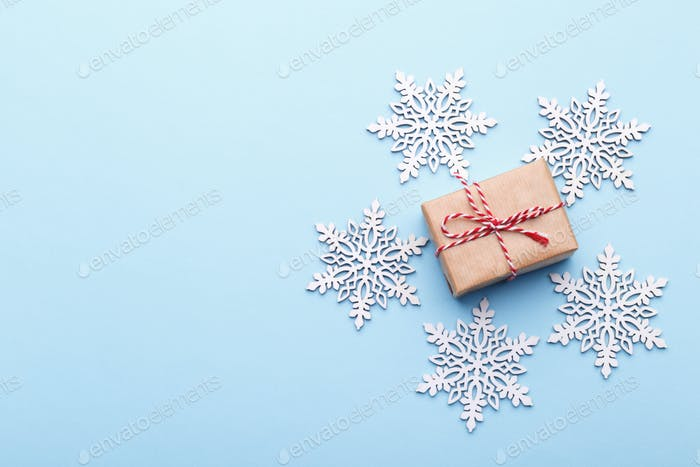 Small gift box on blue background