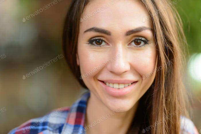 Portrait of young beautiful hipster woman outdoors