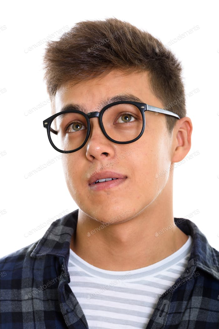 Face of young handsome man wearing eyeglasses while thinking