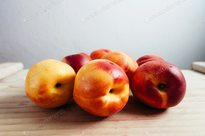juice nectarines on wood table top view