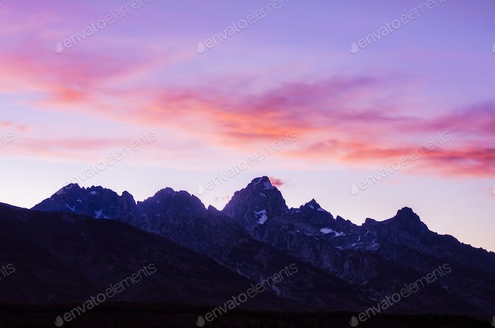 Colorful sunset clouds and Grand Teton mountains, USA