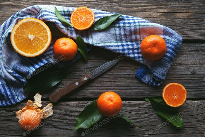 tangerines with a knife on a wooden background. Healthy food. Fruit
