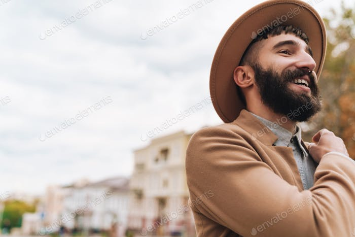 Attractive smiling young man wearing autumn coat