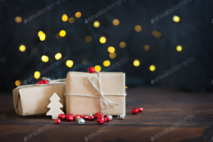 Christmas gifts wrapped in brown paper, bokeh background