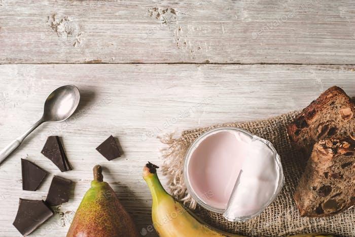 Berry farm yogurt in a jar, chocolate and fruits