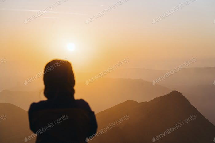 Traveler watching the sunrise