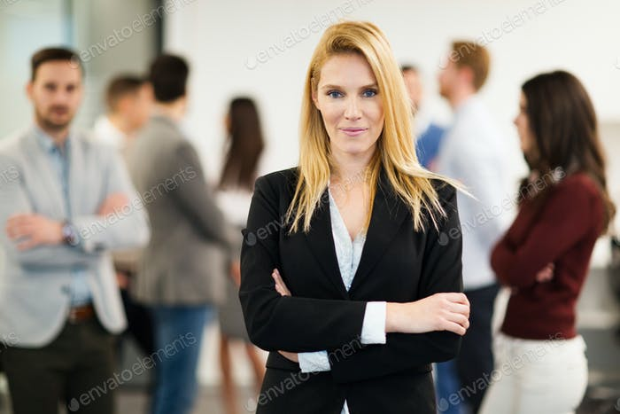 Business lady with positive look posing for camera