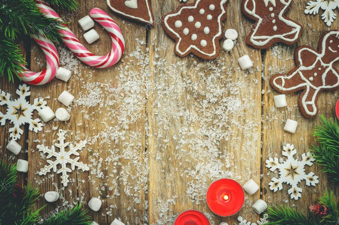 Wood dark background with Christmas tree, candies, cookies, mars