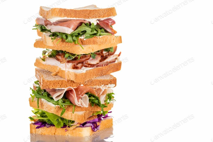 Fresh Sandwiches With Arugula And Meat on White Surface