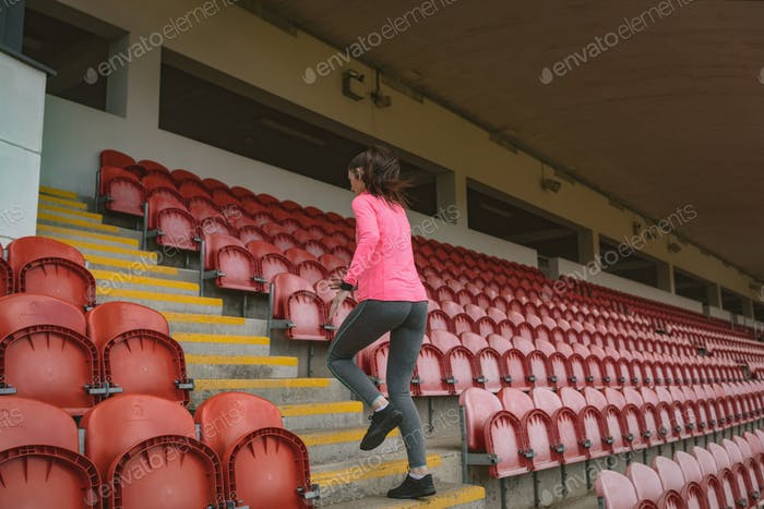 Woman jogging in stadium