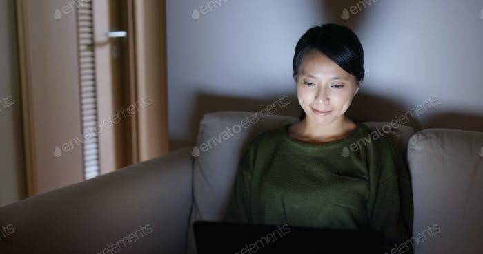 Woman work on laptop computer at home