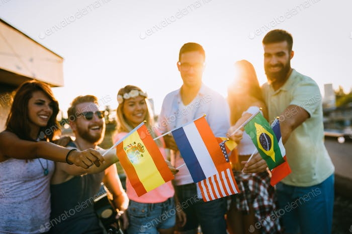 Group of people holding national flags