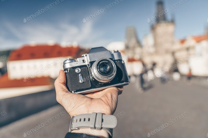 Male hand with a camera in Europe