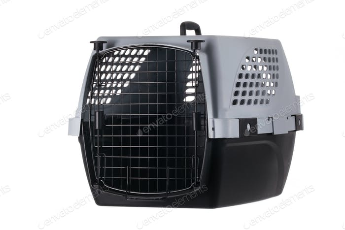 Empty pet carrier with closed door isolated on white background