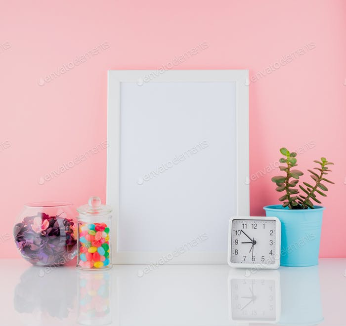 Blank white frame and plant cactus,  sweet candy in jar on white