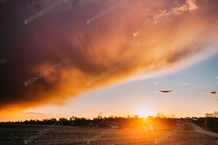 Spring Sunset Sunrise. Sun Above Village In Belarusian Countrysi