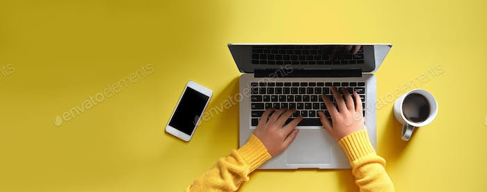 Woman hands using a laptop computer from above