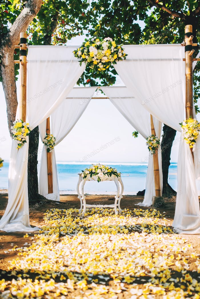 perfect wedding reception, ceremony venue on beach with flower details and ocean view