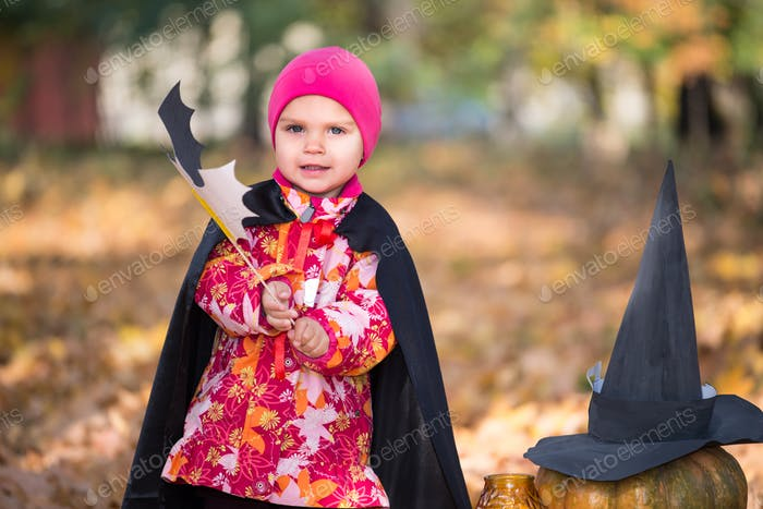 Cute funny little girl in a pink hat