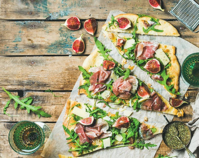 Homemade sage flatbread pizza with rose wine in glasses