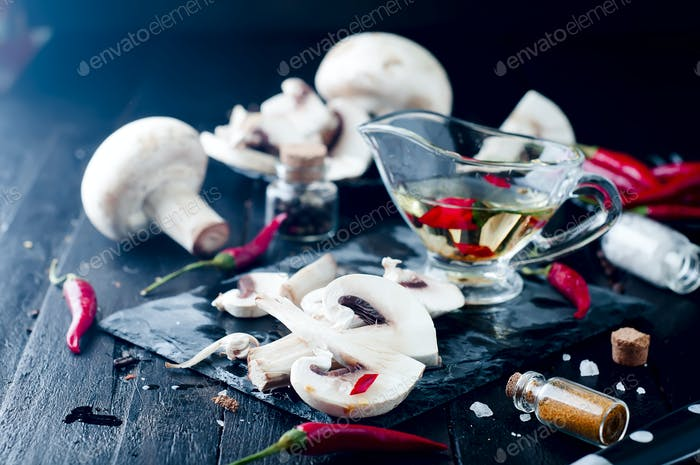 Sliced mushrooms on board.