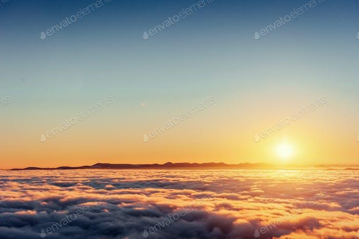 fog in winter mountains. Fantastic sunset. Beauty world. Europe Carpathians.