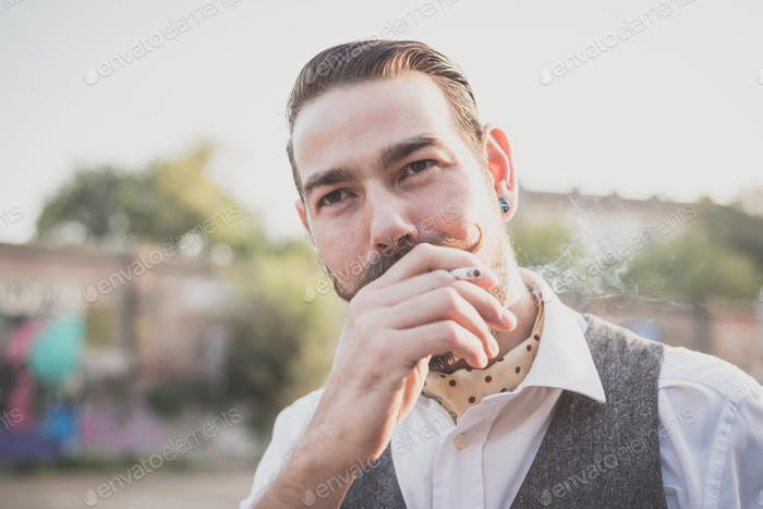 handsome big moustache hipster man smoking cigarette
