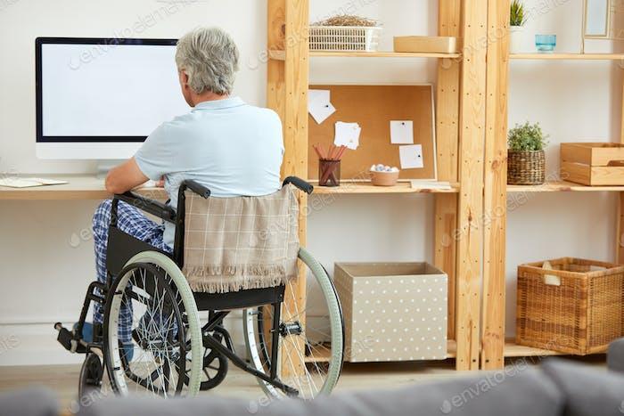 Disabled man watching TV