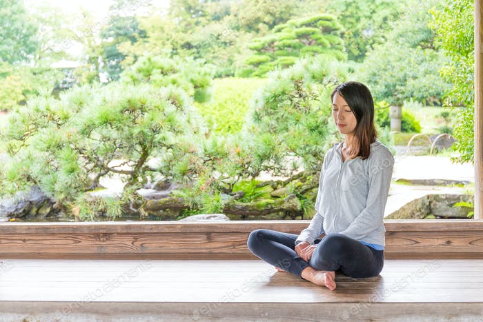 Beautiful Woman Meditating In Nature Photo By Leungchopan On Envato Elements