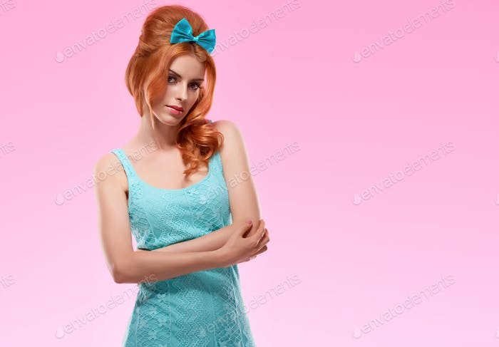 Fashion redhead model in trendy sexy dress, Pinup