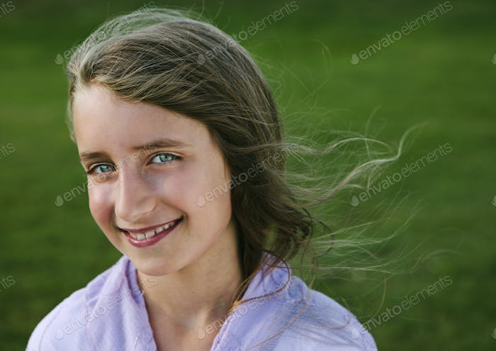 Portrait of a smiling nine year old girl.