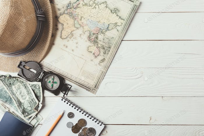 Top view of travel stuff on a white wooden table. Journey concept