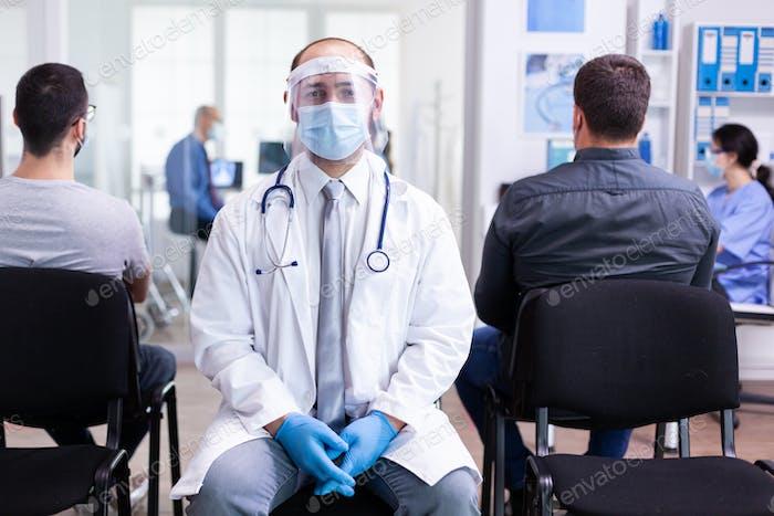 Doctor with visor against coronavirus