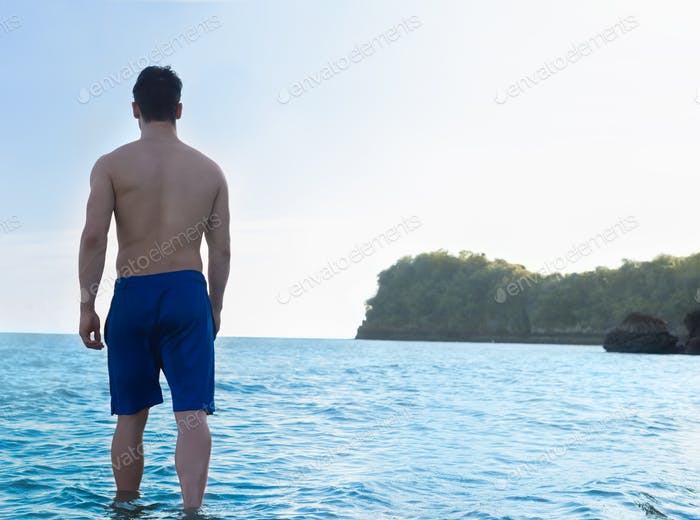 Man Beach Summer Vacation, Young Guy Stand In Water Back Rear View