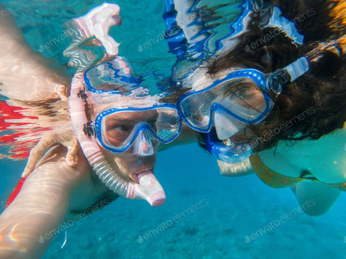 Couple snorkeling underwater in the Red sea