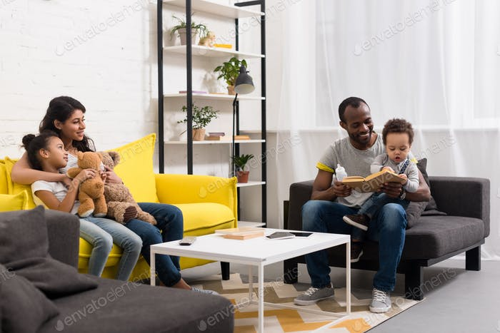happy young parents spending time with kids at home