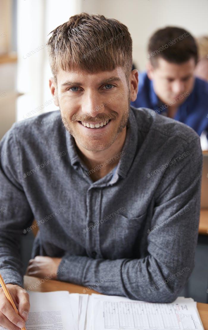 Portrait Of Mature Man Attending Adult Education Class