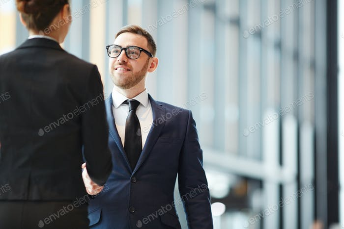 Businessman greeting colleague