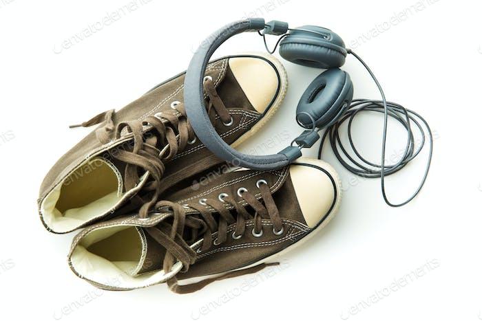 Vintage sneakers and headphones.