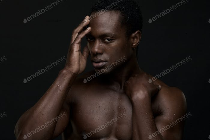 African American Man with Hand to Face